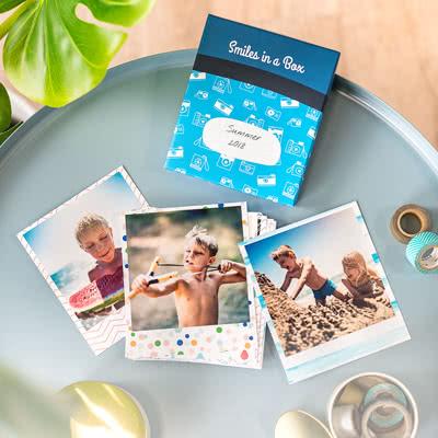 Fotos in der Box Feder blau